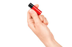 Hand hält eine rote AA-Batterie Stockfotografie