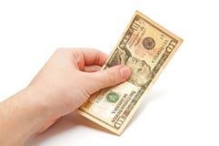 Hand hält einen 10 Dollarschein an Stockbild