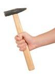 Hand hält Hammer an Lizenzfreies Stockbild