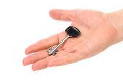 Hand hält modernen Stahlplastikschlüssel. Stockbilder