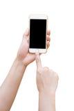 Hand hållande vita Smartphone med den tomma skärmen Fotografering för Bildbyråer