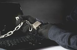 Hand of hacker unlock computer. Dangerous hacker stealing data. Security and risk concept royalty free stock image