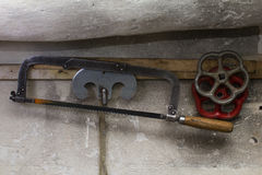 Hand hacksaw hang on wall Royalty Free Stock Image