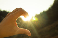 sunshine hand haft heart Royalty Free Stock Photography