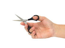 Hand with hair cutting scissors Stock Photo