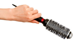 Hand with hairbrush Stock Image