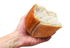 Hand with the half of bread Royalty Free Stock Photos