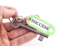 Hand halten Schlüssel zum Erfolg Stockbilder