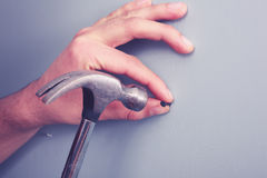Hand hamering Stock Images