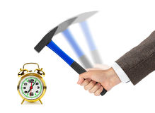 Hand with hammer and alarm clock Royalty Free Stock Images