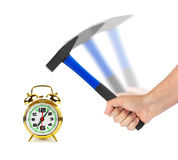 Hand with hammer and alarm clock Stock Image