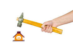 Hand with a hammer and house Stock Photos