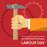 Hand with hammer international labour day Royalty Free Stock Photos