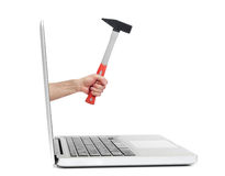 Hand with hammer out of laptop Royalty Free Stock Photo