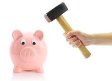 Hand with hammer and piggy bank. Isolated on white Royalty Free Stock Photos