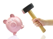 Hand with hammer and piggy bank Royalty Free Stock Photography