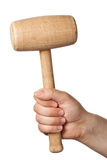 Hand with hammer. Hand with wooden hammer Royalty Free Stock Images