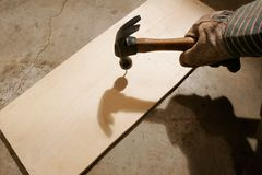 Hand Hammering a Nail Stock Photos