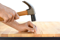 Hand hammering a nail Royalty Free Stock Images
