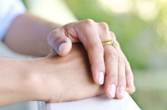 Hand in hand. With golden ring,spirit concept Royalty Free Stock Photos