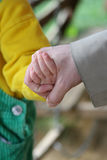 Hand in hand. Child and adult walking hand in hand Royalty Free Stock Image
