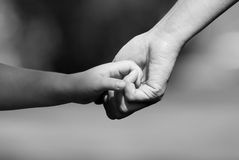 Hand in hand. Mother and child hand in hand together Stock Photography