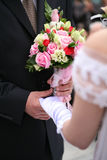 Hand in hand. Bride's hand in Groom's hand on wedding ceremony Royalty Free Stock Image