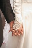 Hand in hand. Bride's hand in Groom's hand on wedding ceremony Royalty Free Stock Images