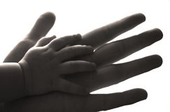 Hand in a hand. Children's hand in a hand of the man Stock Images