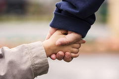Hand in Hand Stock Images