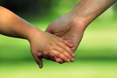 Hand in hand. Mother and child hand in hand Stock Photography