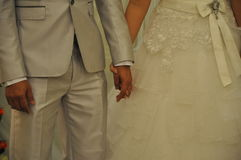 Hand in hand couple. Close up shots of bride and groom holding hands Royalty Free Stock Photos