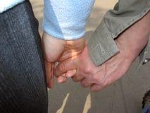 Hand in hand gang Royalty-vrije Stock Afbeeldingen