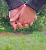 Hand in hand with love. Couple walking hand in hand Stock Photo