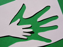 Hand on hand. Paper cutting. Stock Photography