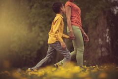 Hand in hand is when they`re happiest. Mother and son in the park stock images