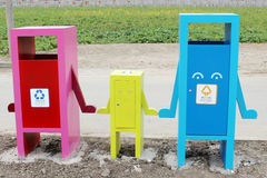 Hand in hand sorting garbage bin. Chinese classified dustbin, environmentally friendly, cute and creative.They're like a family holding hands Royalty Free Stock Images