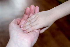 Hand in hand with tenderness. Hands mother and child Royalty Free Stock Photography