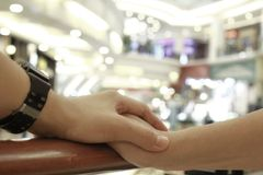 Hand in hand together forever on selective focus. Hand in hand together forever in Town on selective focus Stock Image