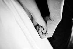 Hand on hand of wedding couple Royalty Free Stock Photos