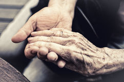 Hand in hand of young and old Stock Photo