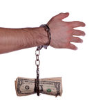 Hand with handcuff and dollars Stock Images