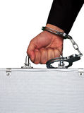 Hand with handcuff and a suitcase Royalty Free Stock Photo