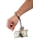 Hand handcuffed to a one dollar banknote Royalty Free Stock Photography