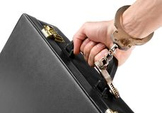 Hand on handcuffs with a briefcase Stock Photo
