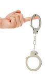 Hand with handcuffs Stock Image