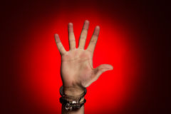 Hand in handcuffs over red background Stock Photos