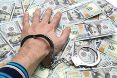 Hand in handcuffs Stock Images
