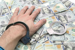 Hand in handcuffs Royalty Free Stock Photos