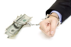 Hand with handcuffs and US dollars Stock Image